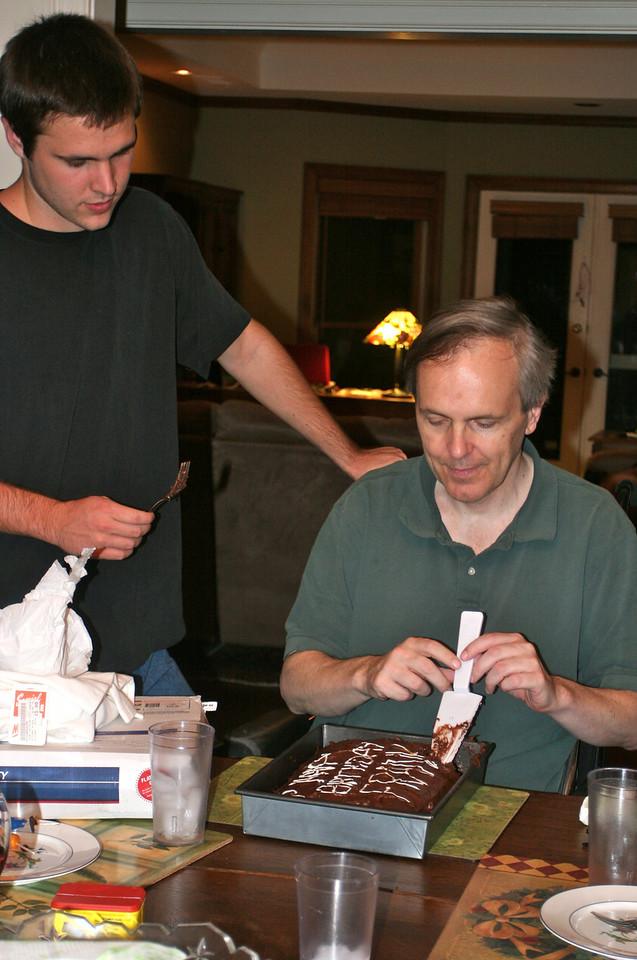 John helps Dad cut the cake