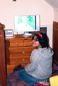 Liz enjoys playing her video game in the new playroom