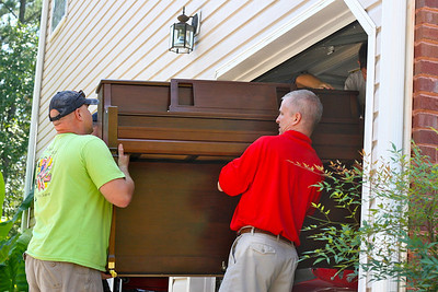 Jerry and Mark moving the piano
