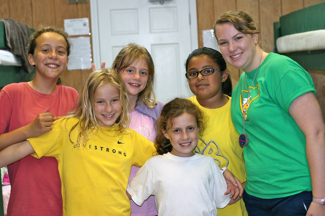 Jackie with counselor and cabinmates at Camp Evergreen