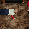 "A progression of his newest trick.  ""Crawling""... Ok, not really crawling, but he'll do anything to get that remote!"
