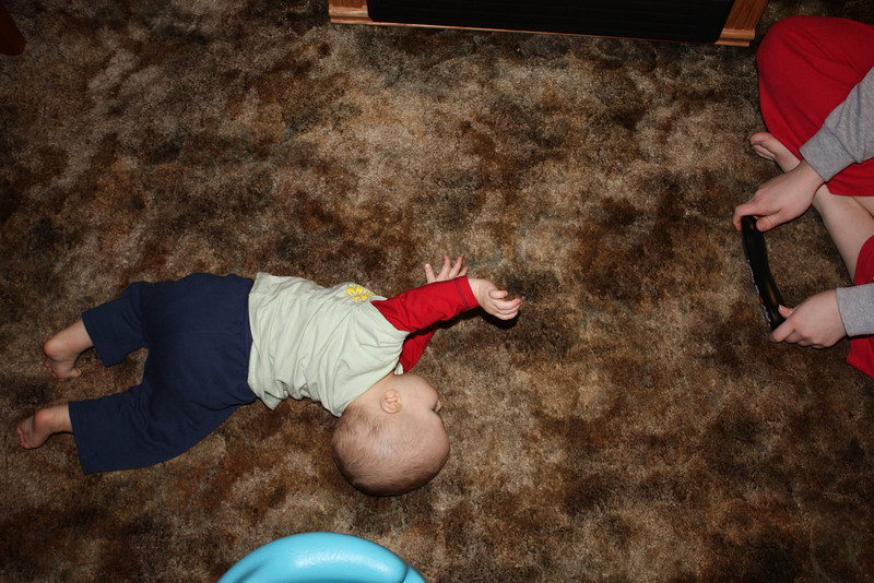 """A progression of his newest trick.  """"Crawling""""... Ok, not really crawling, but he'll do anything to get that remote!"""