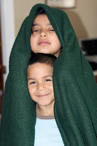 Two-headed monster - Jackie and Miguel in a blanket