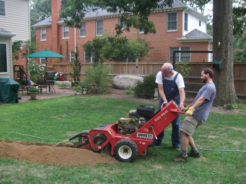 Trenching to run water and electricity to the backyard