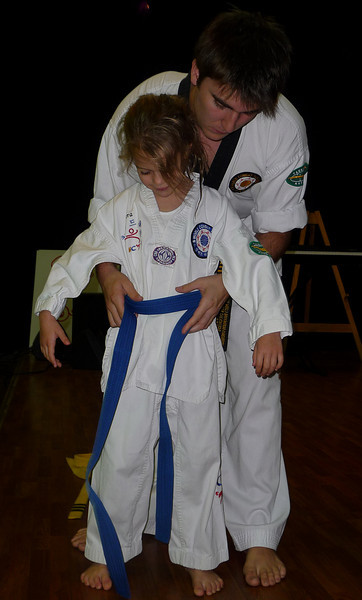 Here is Kiera receiving her Blue Belt from our Instructor, Anthony GIbara.<br /> Kiera has been training now for 15 months.