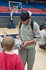 6.25.2009 -- UofA player, Brendon Lavender autographs Connor's basketball.<br /> <br /> The closing ceremonies of the Sean Miller Basketball in which Connor participated.