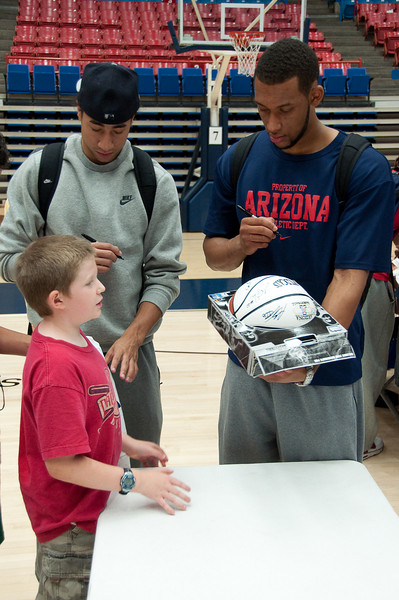 6.25.2009 -- UofA player, Jamelle Horne autographs Connor's basketball.<br /> <br /> The closing ceremonies of the Sean Miller Basketball in which Connor participated.<br /> <br /> The closing ceremonies of the Sean Miller Basketball in which Connor participated.