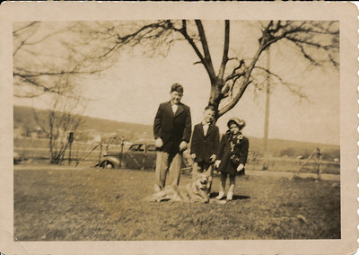 Rusty, Bobby and Anne Marie with Ginger. This is in the early 50s at 633 Valley Street. Today a motel stands on the lot behind us. The West Rock tunnel is to the right of the photographer.