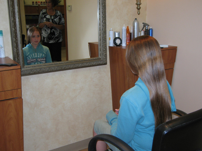 Ellen McCormick haircut of her ponytail for Locks for Love.