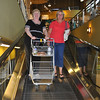 The girls taking a cart down an escalator - another example of Whole Foods forward thinking.