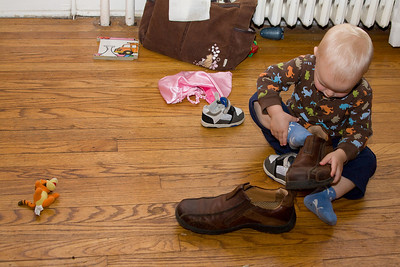 Quinn tries on Daddy's shoes
