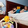 John David sleeps while Shana reads to Carley