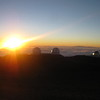 Sunset above the clouds at the top of Mauna Kea