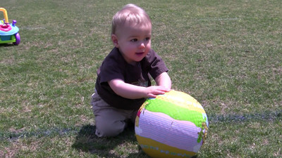 04-15-2010  Evan and I went to the park today to play in the nice soft (and leafless) grass.  He loves to roll his bouncy ball around there.  He's always a good boy but today was an especially happy day for him!