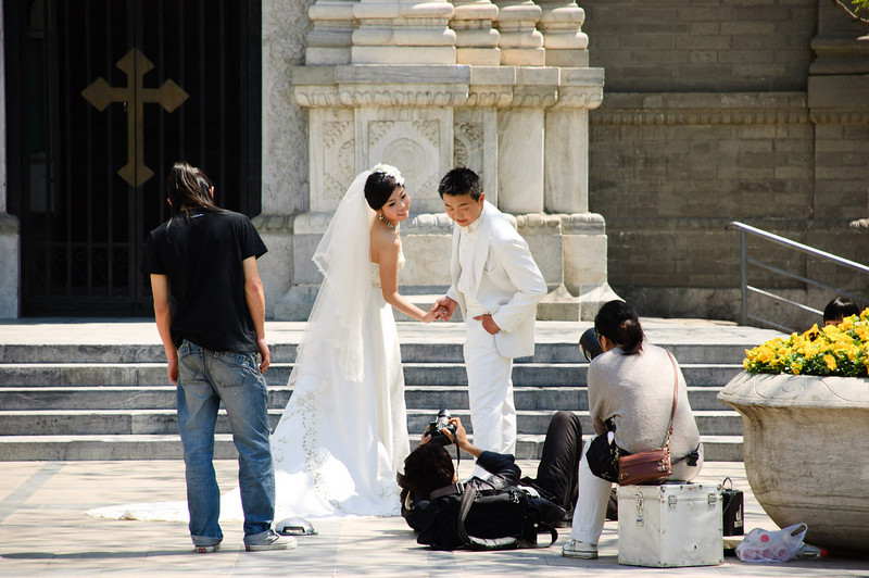 Wedding photography is a major industry in China.  But it is vastly different to what we are used to in NZ.  The photography is often done on a completely different day to the wedding and to me has much more of an orchestrated or artificial air to it.