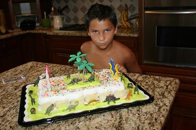 Juan checks out the cake