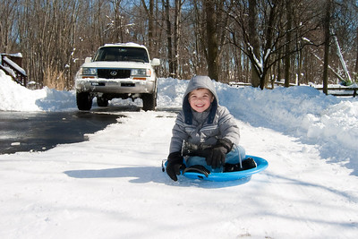 K.C. breaks in his new sled from Santa.