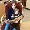 Julie and Madeleine reading together in Cache County.