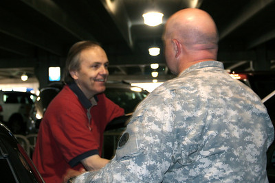 Frank greets Jerry in the parking lot
