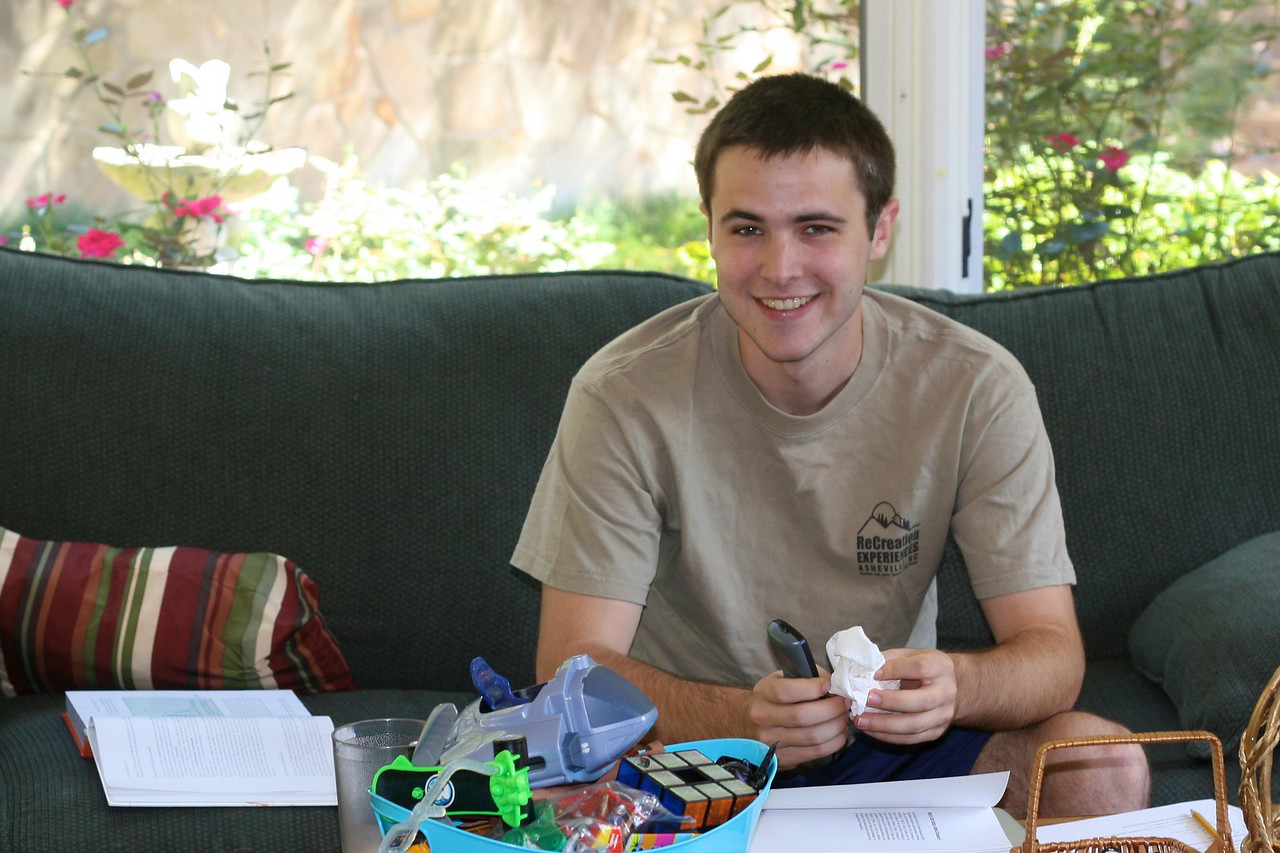 John, home for the weekend, catches up with homework in the sunroom,
