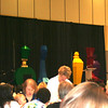 "Eight foot high ""perfume bottles"" that Garry made, disassembled, transported, and rebuilt on the stage for the ladies' luncheon. Great job!"