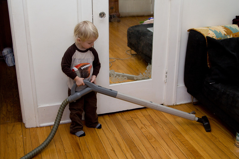 Quinton helps clean up in preparation for his party