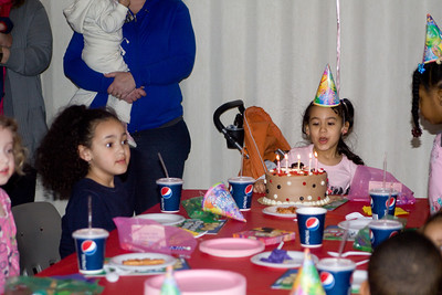 Shayla blows out her candles