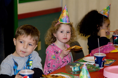 Beverly and Kevin eat pizza at Shalya's birthday party