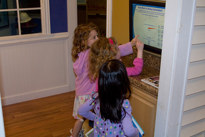 Samantha, Beverly and Kiera look at their energy usage in the Solar House