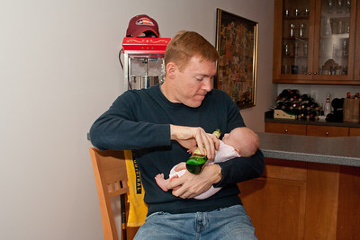 I'm two weeks old and Uncle Erik already has me drinking beer!