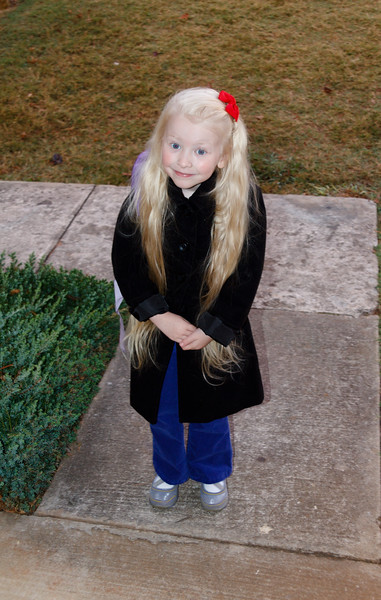 Chloe going to school in her new coat.  Taken by Jenn, October 2011