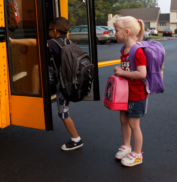 Chloe, apprehensive, before her first time on the school bus.