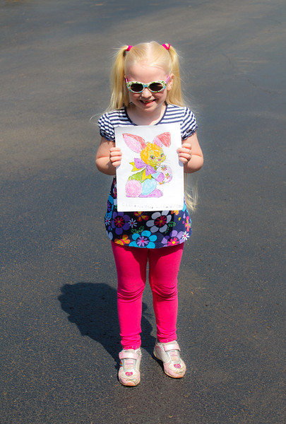 All done!  She chose to make her bunny as colorful as a rainbow...she even glued glitter to the ears, tail, and the little flowers on the egg :)  She was so proud of her picture!