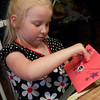 Chloe opening a card from a grandparent.
