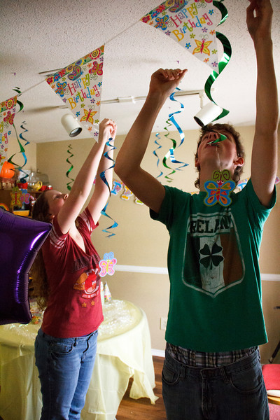 Joshua and Abigail help decorate for Chloe's 6th Birthday Party