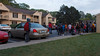 The scene outside our front door every school morning:  the elementary school bus stop.  My Miata far left.  Abigail far right.