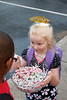 Chloe handing out lollipops at her school bus stop, on her 6th birthday, March 29th, 2012