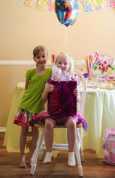 The little girl we know the most, and who's mommy we know the most.  :-)  Thank you both for your smiles!  And your gifts!