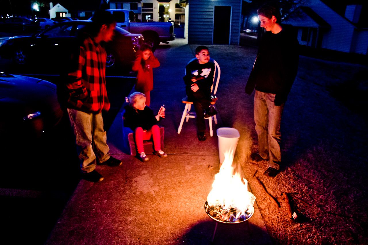 Grilling steaks on the sidewalk outside our apartment - February 2012
