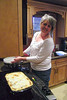 Peggy making lasagna.