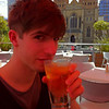 Joel under an orange umbrella - Federation Square, Melbourne
