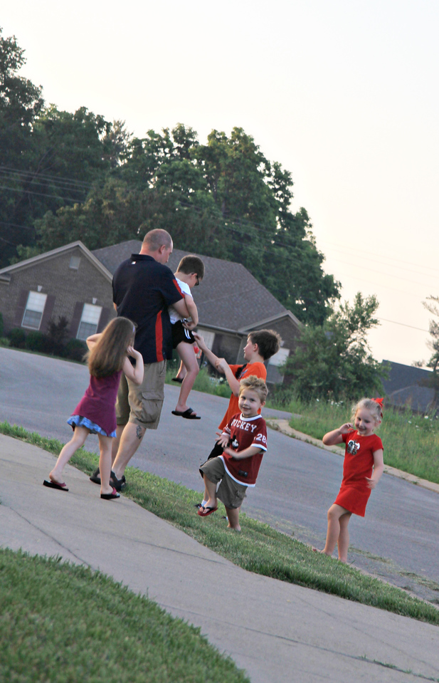 July 2, 2011 at Ben and Marie's house.<br /> Tim helping Ian catch a parachute.