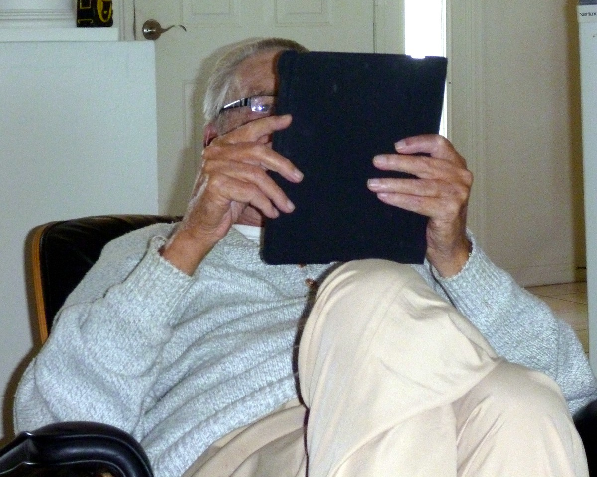 Lou glued to his iPad