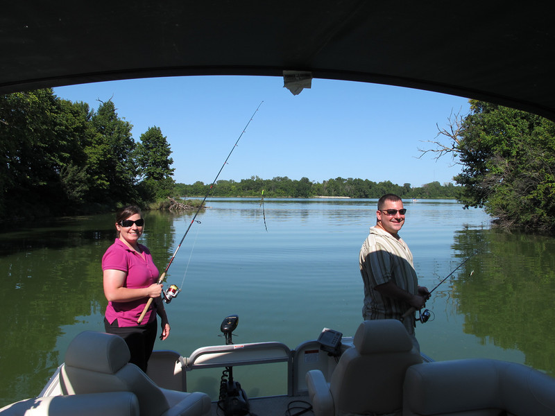 Tracy and Fred pausing while fishing on Big Creek Lake.  Moss and weeds were a problem as seen on Tracy's bait.
