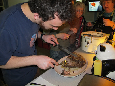 Michael carves his first holiday roast beast.