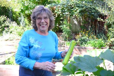 Edna is proud of her back yard veggies