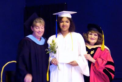 Sam receiving her diploma