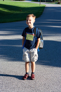 K.C. waits for the bus on his first day of kindergarten.