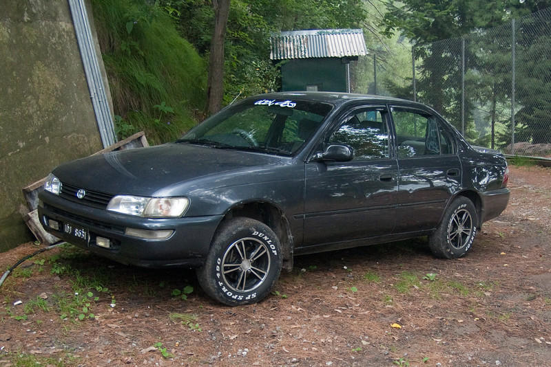 """Our new car! A 1999 Toyota Corolla XE. On the top of the windshield we put a decal that says """"God is King."""""""