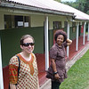 Erin and Mrs. Kaime in front of the senior school classrooms